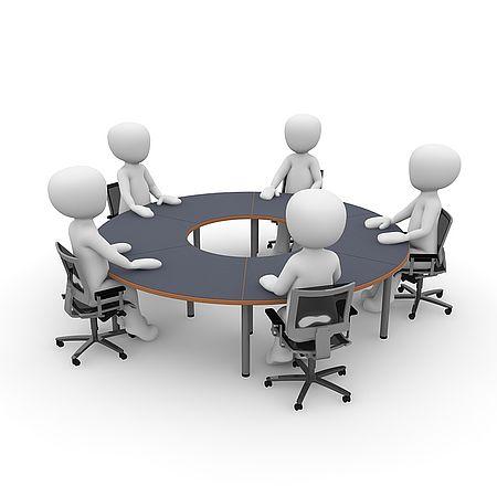 persone stilizzate intorno ad un tavolo in riunione