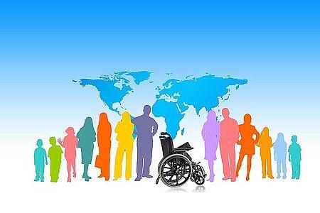 Immagine gruppo persone intorno a sedia a rotelle