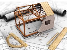 Elaborati grafici di un progetto conun modello di casa in costruzione.